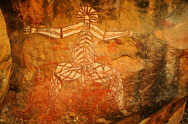 Aboriginal rock art depicting Nabulwinjbulwinj, a dangerous spirit that eats females after striking them with a yam. Kakadu National Park, Northern Territory, Australia.