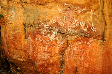 Aboriginal rock art depicting group of people and Namarrgon the lightning spirit. Lightning storms in October and November signal the beginning of the wet season. Nourlangie, Kakadu National Park, Nor...