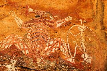 Aboriginal rock art depicting Namarrgon the lightning spirit. Lightning storms in October and November signal the beginning of the wet season. Nourlangie, Kakadu National Park, Northern Territory, Aus...