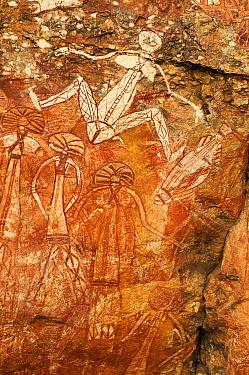 Aboriginal rock art depicting people and fish. Nourlangie, Kakadu National Park, Northern Territory, Australia.