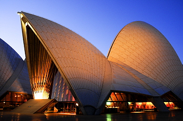 Sydney Opera House illuminated at dusk. New South Wales, Australia. 2008.