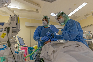Anesthesiologist Thom Jongenelis and anesthesia nurse Monica Spoelstra during an intubation of a patient infected with Covid-19 in the intubation room of the operating theatre Jeroen Bosch Ziekenhuis...