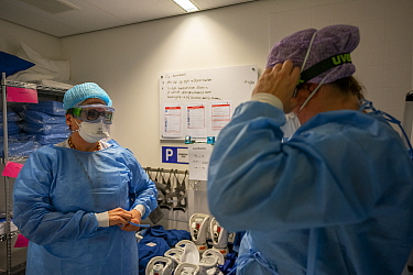 "Preparing to enter the Corona unit of the ICU. Putting on PPE and checking each other with a ""buddy check"" Jeroen Bosch Ziekenhuis, Den Bosch, 's Hertogenbosch, The Netherlands March 2020. EDITO..."