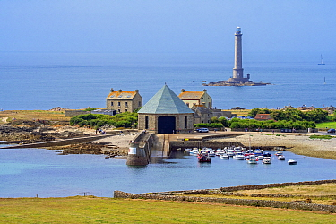 Phare de Goury lighthouse and lifeboat station in the port near Auderville at the Cap de La Hague, Cotentin peninsula, Lower Normandy, France. August 2020