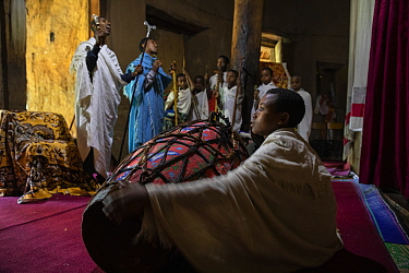 Deacons and students singing during Sunday service at Debre Sina Orthodox Church. Near Gorgora, Ethiopia. 2018.