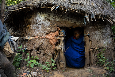 Church student in hut within grounds of Zara Michael Ethiopian Orthodox Church. Near Hamusit, Ethiopia. 2018.