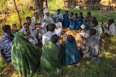 Priests teaching students in forest of Wagira Maryam Orthodox Church. Near Hamusit, Ethiopia. 2018.
