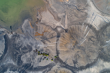 Aerial view of ash pond near Belgrade, Serbia. Circular shapes created by water irrigation. If the ash is dry, wind often blows it to the capital of Serbia, creating toxic air pollution. The ash is a...