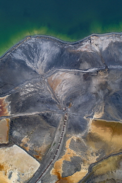 Aerial view of ash pond near Turek, Poland. Former open pit coal mine now used to store coal ash after burning in power plants. The ash is mixed with water and pumped through a pipeline into the ash p...