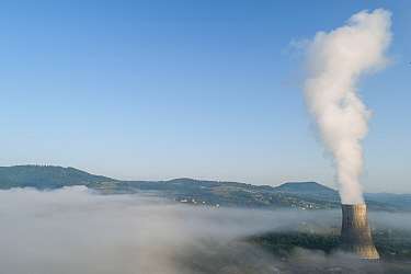 Cooling tower of thermal power plant in Montenegro, surrounded with fog.