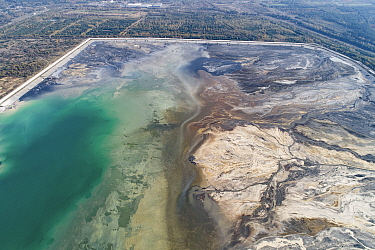 Aerial view of ash pond near city of Lodz, Poland. After coal is burned in power plants, the waste ash is mixed with water and pumped through pipelines into sludgy lagoons commonly known as ash ponds....