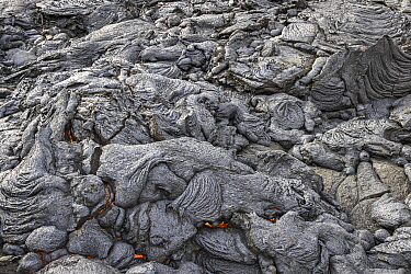 Field of solidified lava, with flowing lava underneath, at the Fagradalsfjall volcano, Iceland. 4 April 2021.