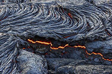 Close-up of solidified lava and fluid lava underneath, taken at the edge of the lava field at the Fagradalsfjall volcano, Iceland, 4 April 2021.