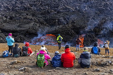 Icelandic people watching and photographing the lava at the eruption site of the Fagradalsfjall volcano, Iceland. 5 April 2021