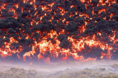 Edge of the lava field at the Fagradalsfjall volcano. Lava is flowing out of Fagradalsfjall at about 1,500 gallons per second, according to the RUV, Icelandic National Broadcasting Service. 2 April 20...