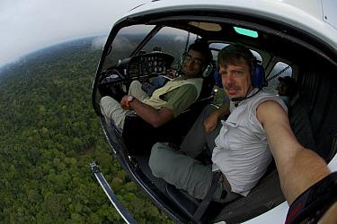 Anand Varma (left) and photographerTim Laman aboard a helicopter flying west of Yasuni National Park, Francisco de Orellana Province, Ecuador, July.