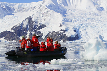 Tourists taking pictures on a zodiac boat ride, Neko Harbor, Andvord Bay, Antarctica, February 2011.
