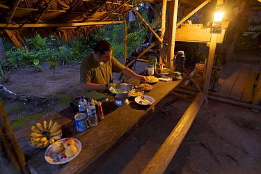 Edwin Scholes in hut in Kali Batu Putih, Halmahera, Indonesia. July 2008.