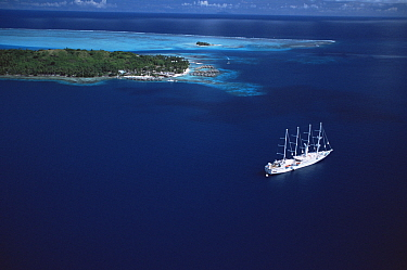 Aerial view of Luxury cruise ship in the lagoon at Bora Bora Island, Society Islands, French Polynesia, June 2002.