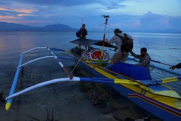 Boarding pumpboat used to travel from Foli to Labilabi along the Halmahera coast, Maluku Islands, Indonesia 2008