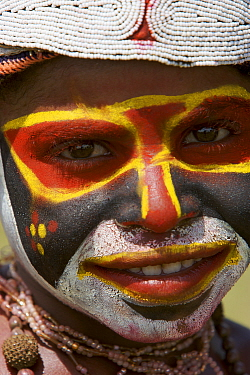 Villager in traditional costume with painted face at Goroka Cultural Show in the Eastern Highlands Province, Papua New Guinea. September 2004