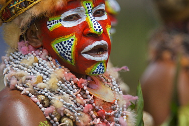 Villager in traditional costume and painted face at Goroka Cultural Show in the Eastern Highlands Province, Papua New Guinea. September 2004