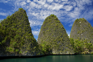 A trio of peaks in the Wayag Islands, an uninhabited group of uplifted limestone (karst) islands, NW of Waigeo Island. West Papua, Indonesia, April 2007
