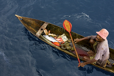 At sea off the Fak Fak Peninsula, a fisherman in a canoe caught a variety of fish including tuna, snappers, and groupers on a hand line. This is a good example of a healthy fishery. West Papua, Indone...