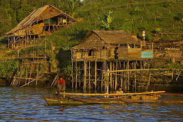 Semi-permanent fishermans camp at Tanjung Besi, Gam Island. These outsiders from Buton Island, Sulawesi, come here for months at a stretch to fish at night for small fish. Men prepare to take their b...