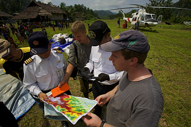 Foja Mountains expedition members planning their drop location with helicopter pilots. Kwerba Village, Papua, Indonesia, 2008. (taken during Conservation International Rapid Assessment Program expedit...
