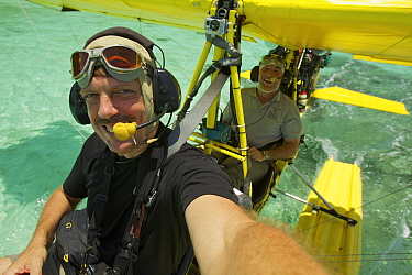 Photographer Tim Laman in the front seat with pilot Max Ammer in ultralight float plane before take off to shoot aerials of the Raja Ampat Islands, West Papua, Indonesia. October 2010