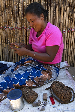 Woman with tobacco for sale, local market, South Madagascar. October 2018.