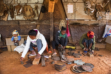 Deaf workers, in metal factory, making metal artefacts for tourist industry, Antananarivo, Madagascar. October 2018.