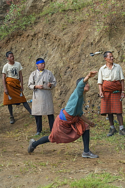 Men playing with wooden darts known as khuru, played during festivals. Bhutan. September 2013.