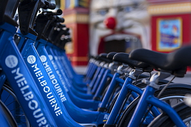 Melbourne Bike Share bikes racked up in front of Luna Park in St Kilda, Victoria, Australia. May 2016