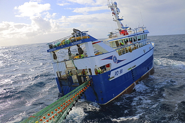 Fishing vessel Harvester' retriving net while fishing at sea area Rockall. April 2020. Property released.