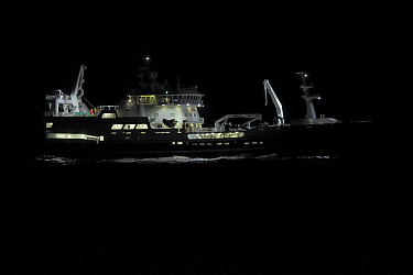 Norwegian fishing vessel trawling for herring on the North Sea at night. August.