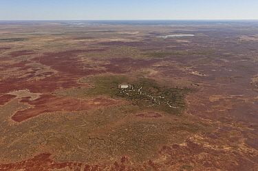 Aerial of Dam in the Strzelecki Desert for cattle just out of Birdsville belonging to Pandie Pandie Station. Dam water comes from bore water from the Great Artesian Basin, South Australia, June 2011