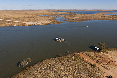 Aerial view of the Cooper Creek Crossing with a 'punt' or ferry servicing the vehicle driving public to cross the road, South Australia, June 2011