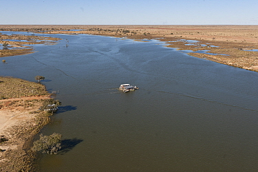 """Aerial view of the Cooper Creek Crossing with a """"punt"""" or ferry servicing the vehicle driving public to cross the road, South Australia, June 2011"""