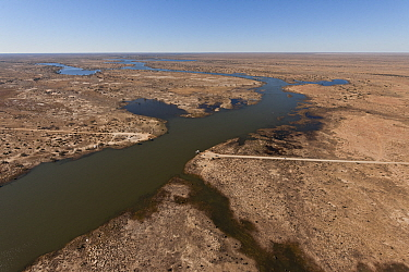 """Aerial view of the Cooper Creek Crossing with a """"punt"""" or ferry servicing the vehicle driving public to cross the road, South Australia, July 2011"""