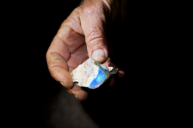 Andamooka opals held in hand, South Australia, June 2011