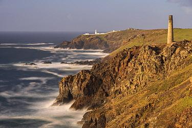 Pendeen Lighthouse and Cornish coastle, taken from Levant tin mine, Trewellard, Cornwall, England, UK. May 2021.
