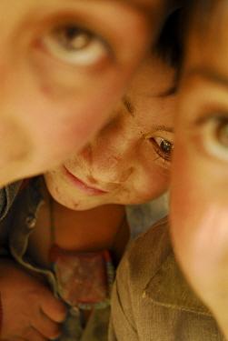 Close up portait of three children, Askole village (3,000m), Braldu Valley, Karakoram Range, Pakistan, July 2007.