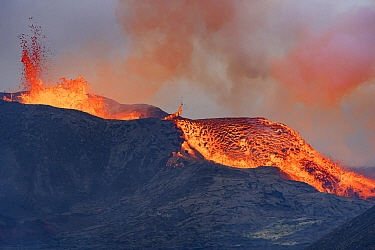 Active volcano erupting with lava overflowing from the crater to lava fields. The volcano has been dormant for 6000 years. Fagradalsfjall Volcano, Iceland, Europe, 5 June 2021.