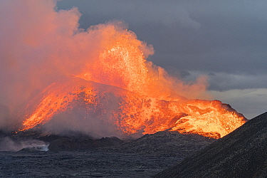 Large volcanic eruption with lava overflowing to lava fields. The volcano has been dormant for 6000 years. Fagradalsfjall Volcano, Iceland, Europe, 5 June 2021.