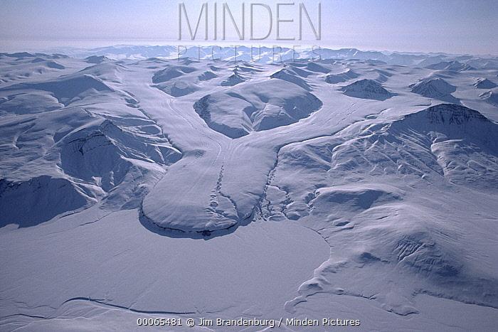 Converging glacier and snow covered mountain, Ellesmere Island, Nunavut, Canada  -  Jim Brandenburg
