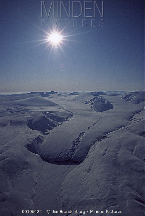 Sun shining over glacier, Ellesmere Island, Nunavut, Canada  -  Jim Brandenburg