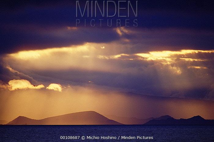 Sunset over Galapagos Islands, Ecuador  -  Michio Hoshino