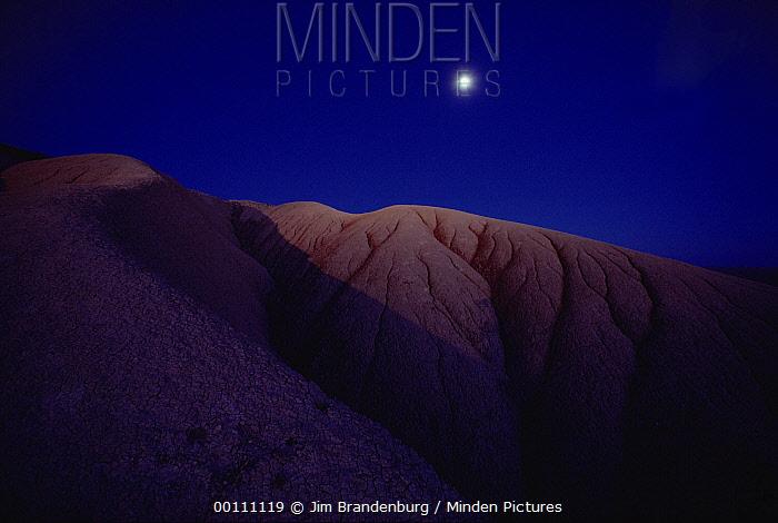 Badlands National Park by moonlight, South Dakota  -  Jim Brandenburg